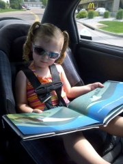 Kid-Reading-in-the-Car
